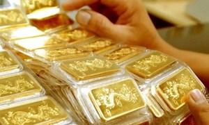 Giá vàng thế giới tụt giảm chớp nhoáng do áp lực chốt lời tăng mạnh