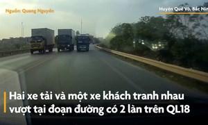 [Video] Hai xe tải, một xe khách tranh nhau vượt trên đường hẹp