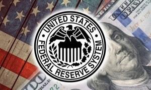 Fed giữ lãi suất ổn định và giảm dần kích thích kinh tế