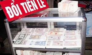 Đổi tiền lẻ dịp Tết: Càng cấm, phí càng cao