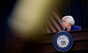 Vàng, chứng khoán phản ứng sau quyết định của Fed