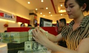 Giữ tiền đồng hay ngoại tệ?