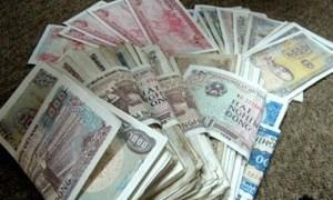 Hạn chế in, sử dụng tiền lẻ mới trong dịp Tết 2014
