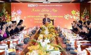 Chủ tịch Quốc hội Nguyễn Sinh Hùng đến thăm và chúc tết BIDV
