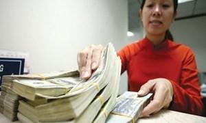 Vì sao tiền VND bị định giá cao?