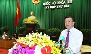 Bộ trưởng Đinh Tiến Dũng trình bày Tờ trình dự án Luật Quản lý, sử dụng vốn nhà nước đầu tư vào sản xuất kinh doanh