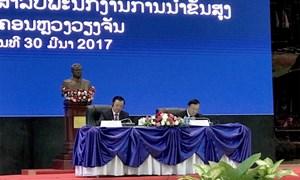 Bộ trưởng Bộ Tài chính Đinh Tiến Dũng thăm và làm việc tại CNDCND Lào