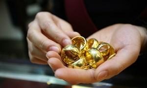 Áp lực giảm giá đè nặng lên vàng