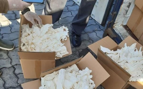 Bắt 2 container găng tay đã qua sử dụng nhập khẩu từ Trung Quốc