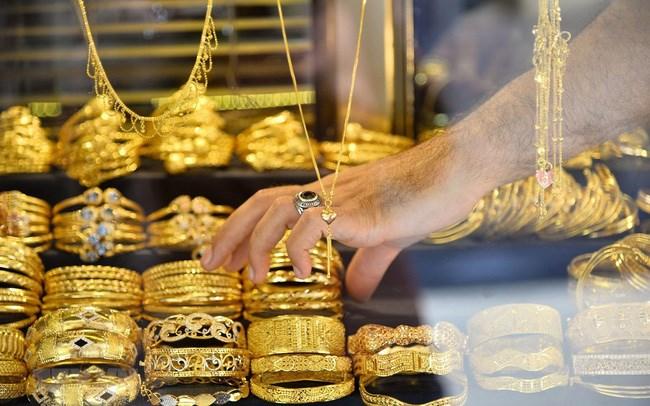 Vàng quay đầu tăng mạnh lên trên 1.500 USD/ounce