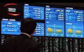 Sau địa chấn phố Wall, các thị trường tài chính châu Á phản ứng dữ dội