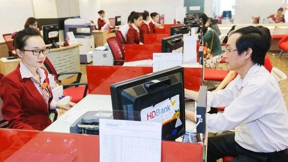 Ngân hàng đẩy vốn vào kinh doanh dịp cuối năm