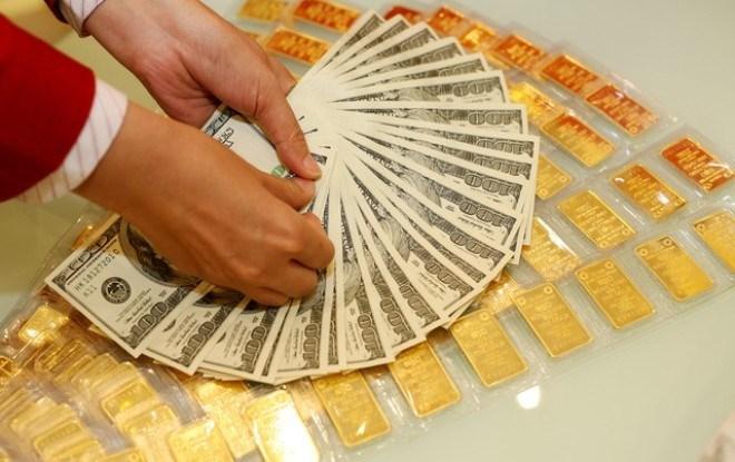 Giá USD đi xuống đẩy vàng quốc tế nhích lên