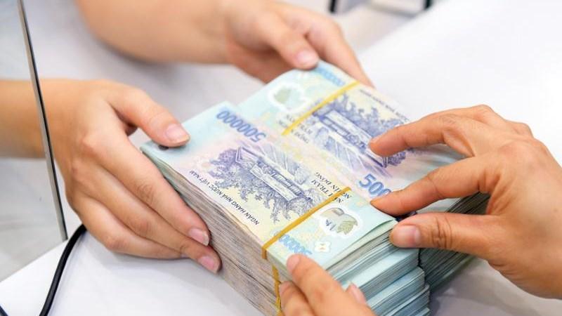 Ngân hàng rầm rộ báo lãi, vẫn lo nợ xấu tăng