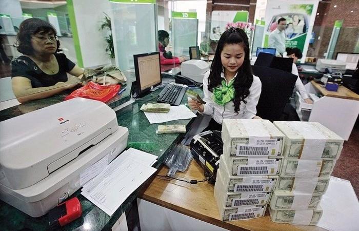 Ngành ngân hàng cam kết giảm tiếp 0,5% lãi suất cho vay