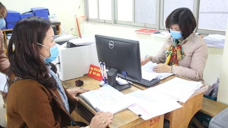 BHXH Việt Nam và VietnamPost chi trả lương hưu và trợ cấp BHXH qua ATM, tại nhà
