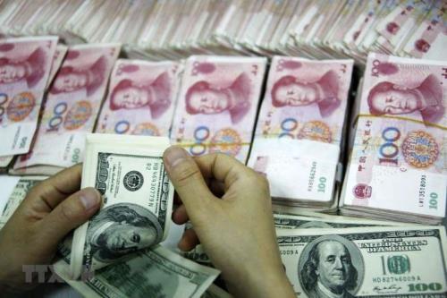"""Đồng USD bị """"thất sủng"""" trong một số giao dịch quốc tế"""