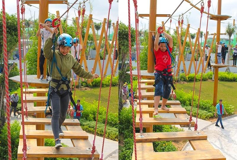 Các bạn trẻ trải nghiệm trò chơi tại tổ hợp Adventure Forest trong ngày khánh thành công viên Gem Sky Park. Ảnh : DXG