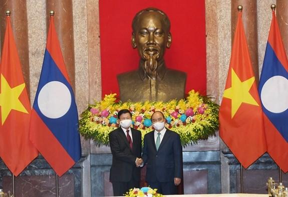 Chủ tịch nước Nguyễn Xuân Phúc và Tổng Bí thư, Chủ tịch nước Lào Thongloun Sisoulith. Ảnh: TRỌNG HẢI