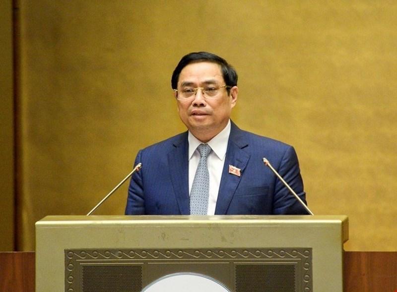 Thủ tướng Chính phủ Phạm Minh Chính trình bày Báo cáo giải trình, tiếp thu ý kiến của đại biểu Quốc hội về cơ cấu tổ chức của Chính phủ nhiệm kỳ 2021-2026.