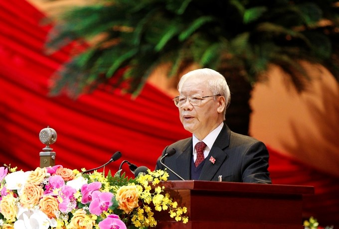 Đồng chí Nguyễn Phú Trọng, Tổng Bí thư Ban Chấp hành Trung ương Đảng, Chủ tịch nước CHXHCN Việt Nam trình bày Báo cáo chính trị của Ban Chấp hành Trung ương Đảng khóa XII và các văn kiện trình Đại hội.