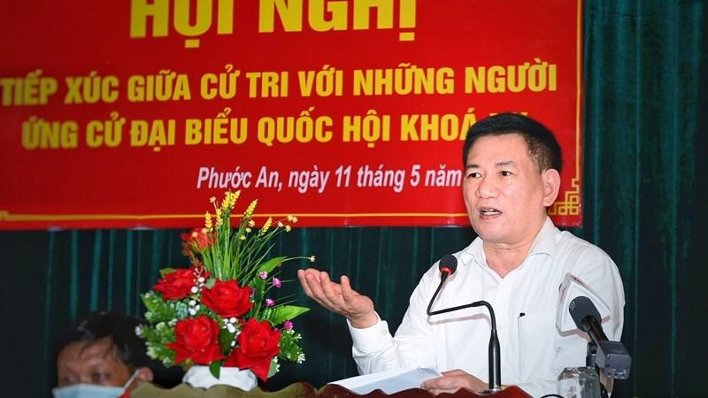 Bộ trưởng Bộ Tài chính phát biểu tại Hội nghị tiếp xúc cử tri xã Phước An, huyện Tuy Phước, tỉnh Bình Định, chiều ngày 11/5/2021. Ảnh: Minh Tuấn