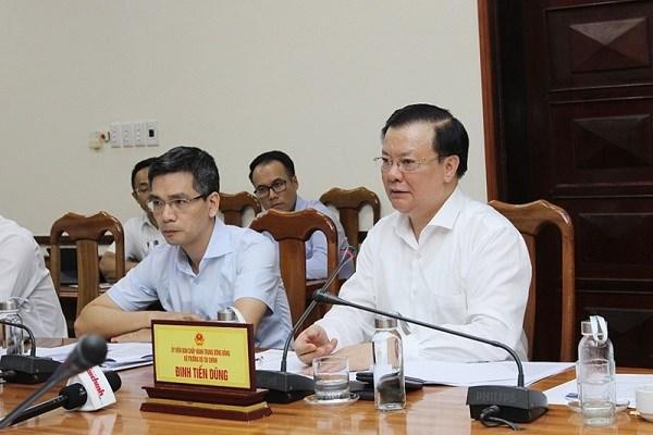 Bộ trưởng Đinh Tiến Dũng phát biểu tại buổi làm việc với UBND tỉnh Quảng Bình.