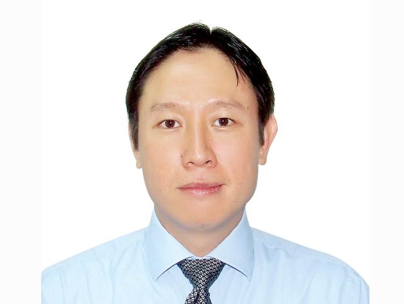 Chuyên gia tài chính Huỳnh Trung Minh.