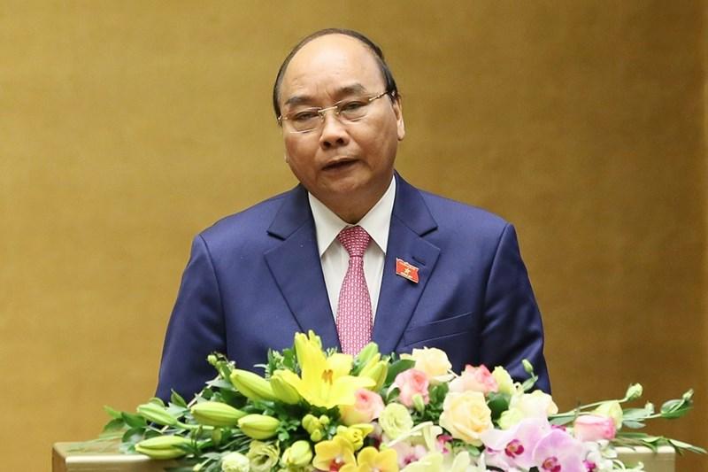 Thủ tướng Chính phủ Nguyễn Xuân Phúc báo cáo về kết quả thực hiện kế hoạch phát triển kinh tế - xã hội năm 2019; kế hoạch phát triển kinh tế - xã hội năm 2020. Ảnh: VGP