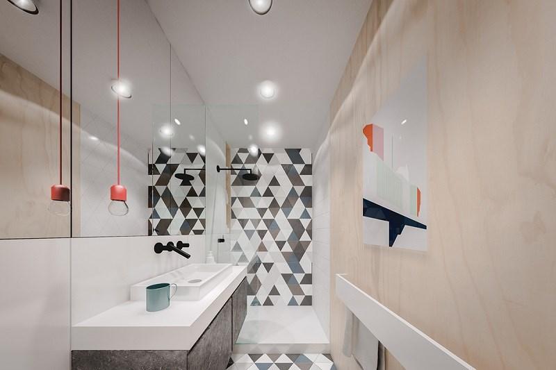 Khu vực phòng tắm lại có một cách tiếp cận hòan toàn khác biệt so với phần còn lại của căn hộ.
