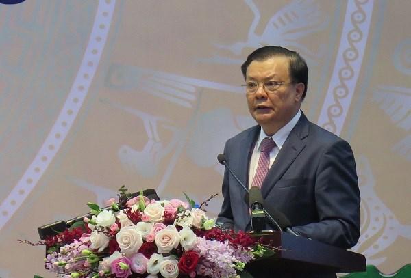 Bộ trưởng Bộ Tài chính, Chủ tịch Hội đồng Quản lý BHXH Việt Nam Đinh Tiến Dũng phát biểu tại Hội nghị.